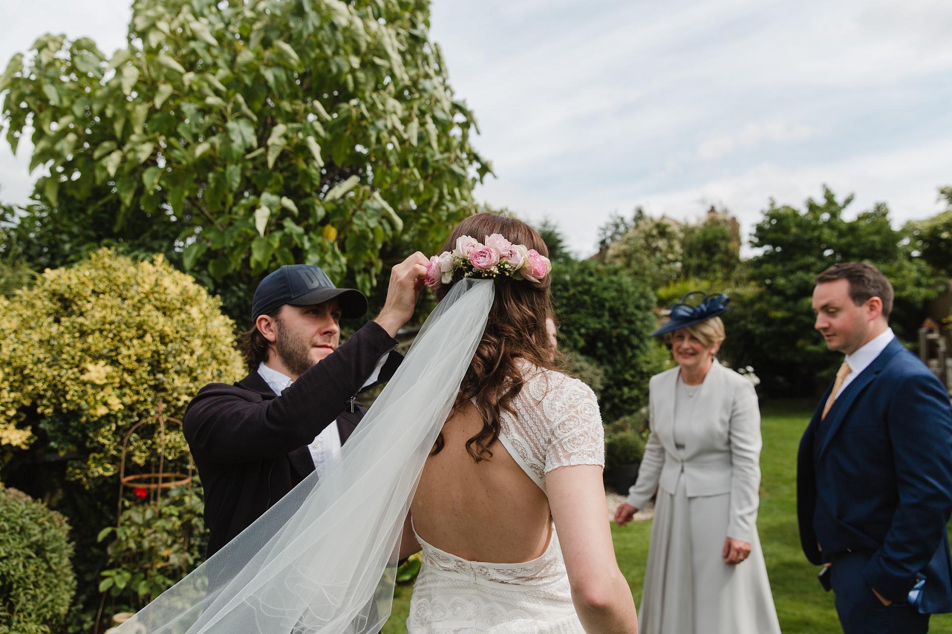bride putting in veil wedding morning