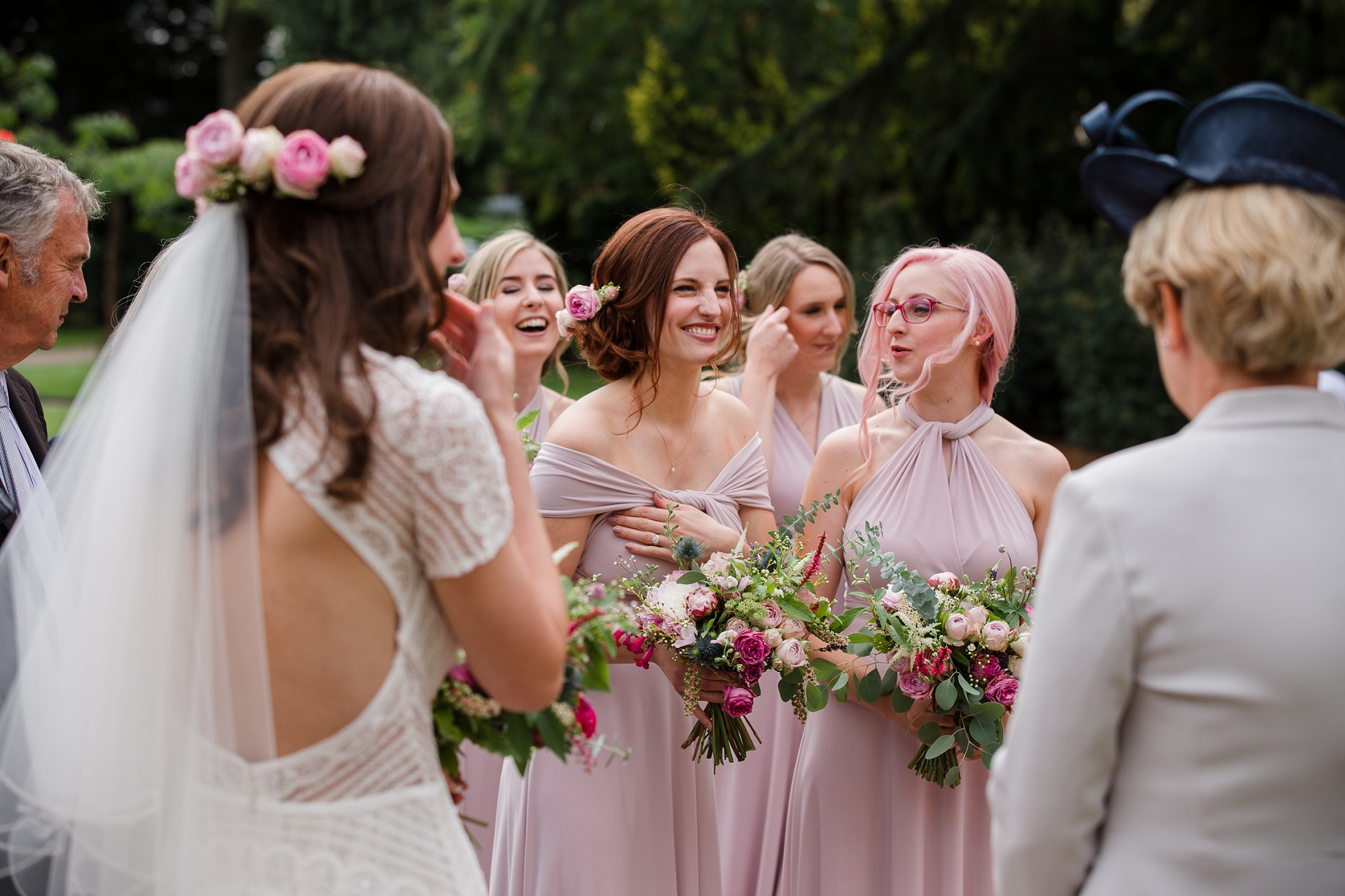 bride and bridesmaids candid moment