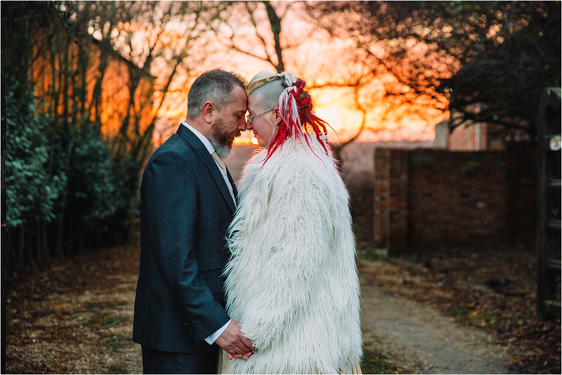 alternative bride and groom at sunset