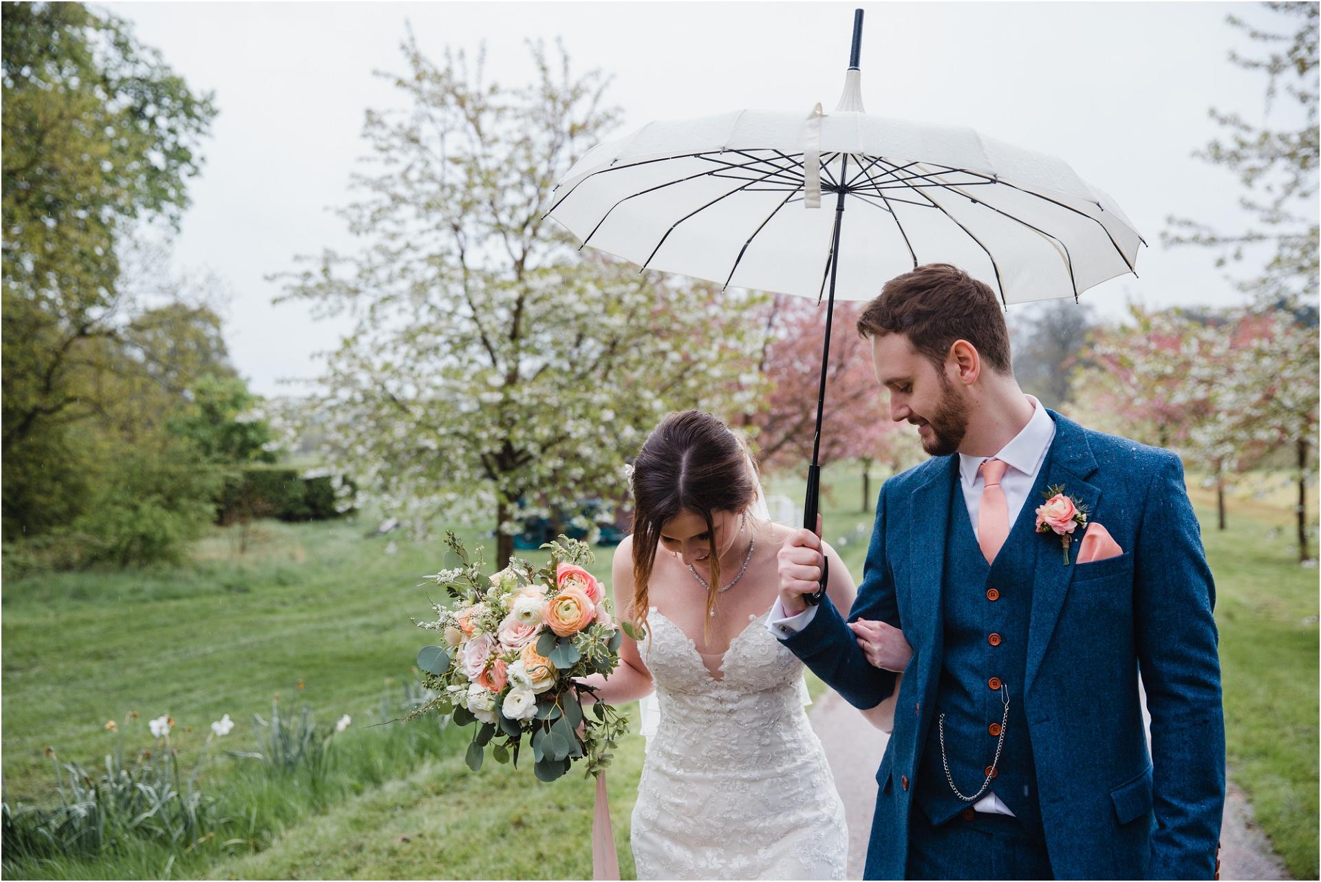 Rainy wedding umbrella photography