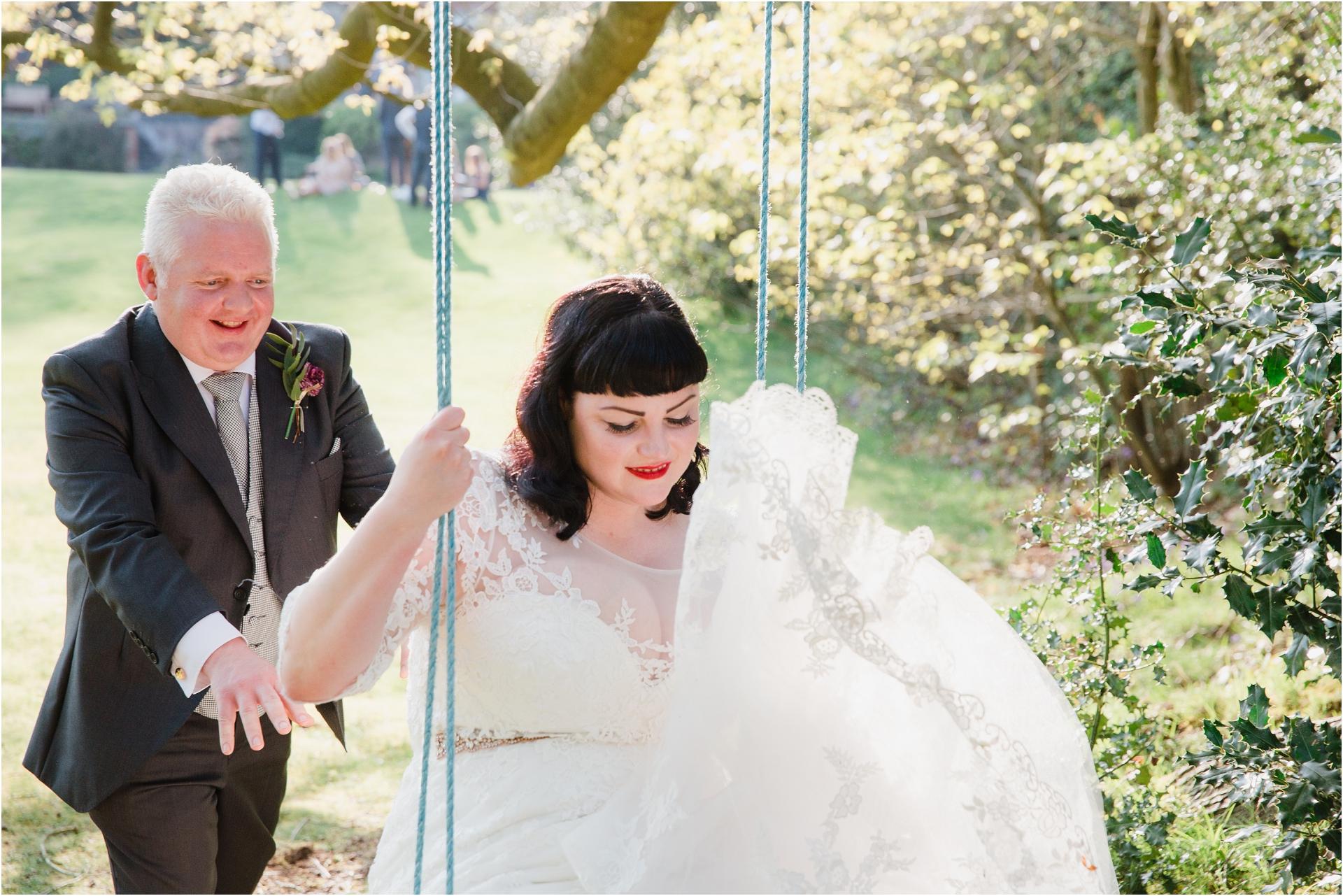 Wedding couple on a swing