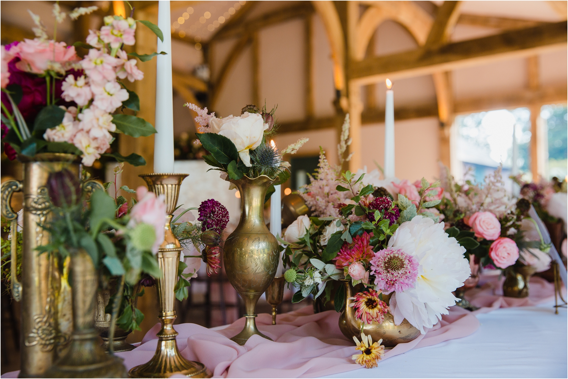 wedding flowers and brass vase Hazel Gap Barn