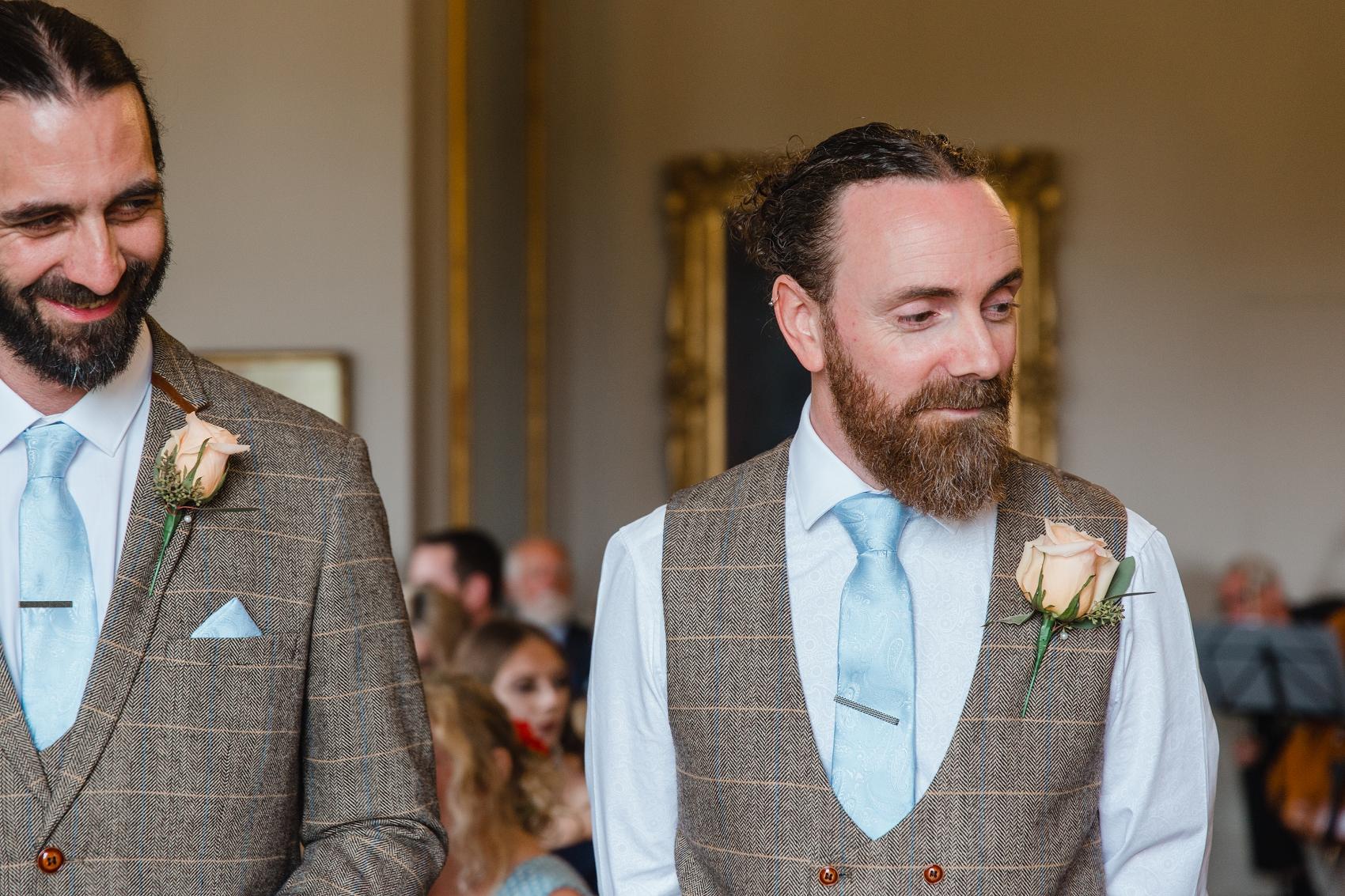 Alternative groom style tweed and beard