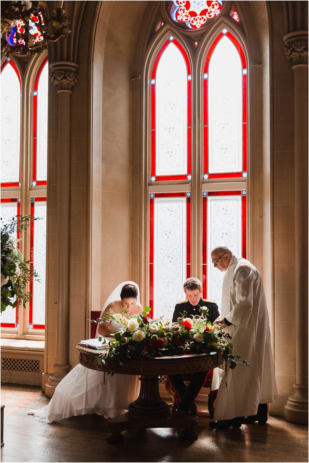 signing the register Belvoir Castle wedding