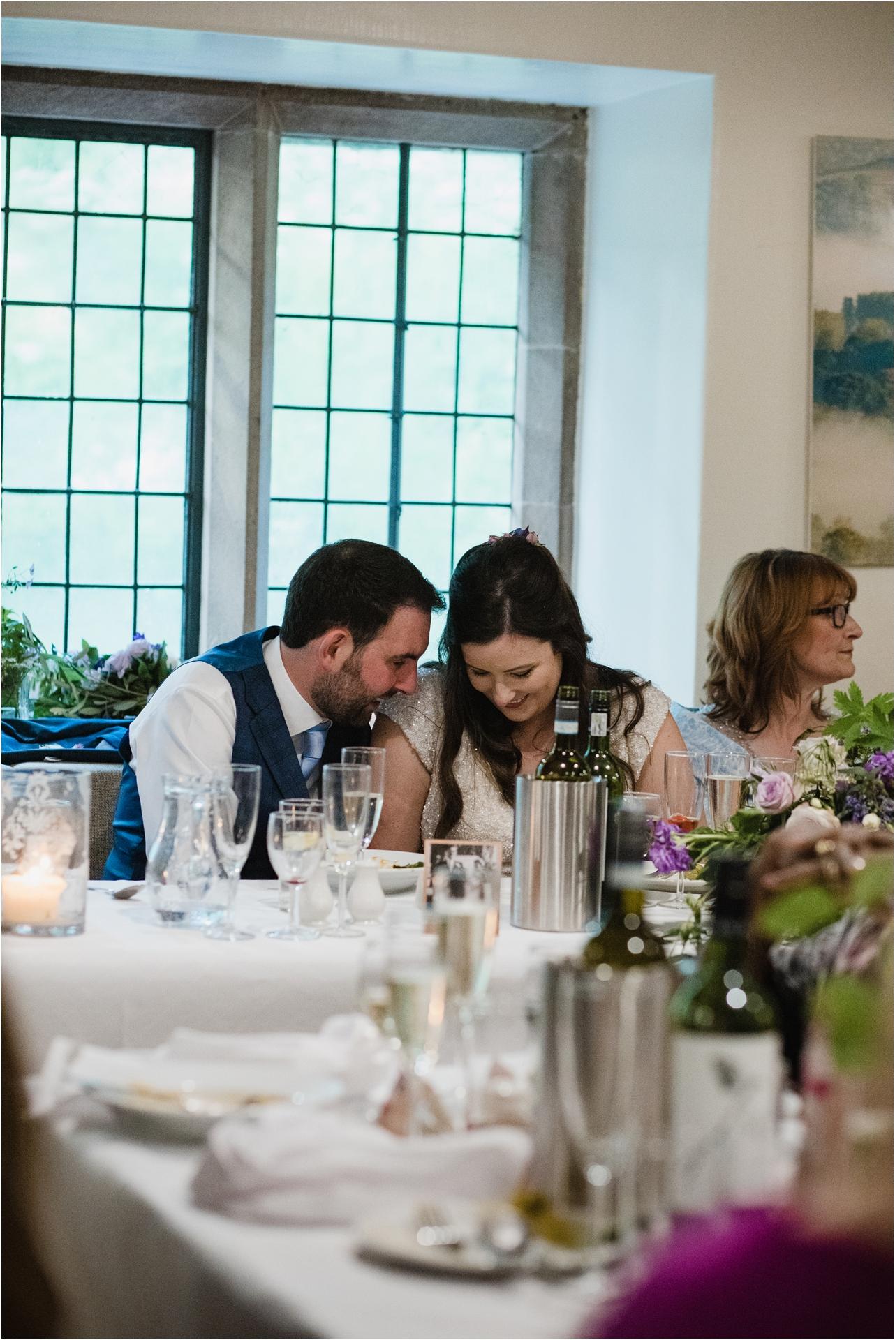 Moment between bride and groom Haddon Hall